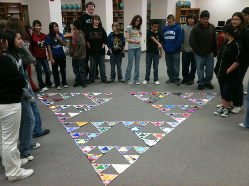 Children from the MESA club in Carlsbad NM displaying their contributions to the Trianglethon.