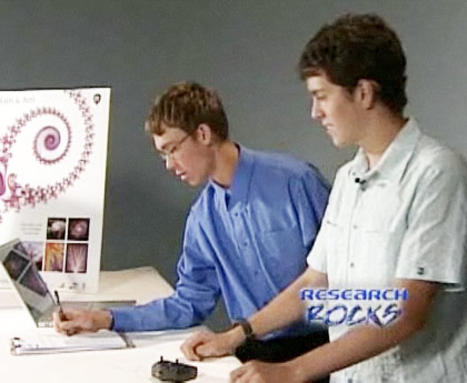 Christian Meyer and Claudio Gonzalez, demonstrating their fractal antenna.