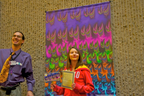 Olivea R, a 6th grade student in front of her winning fractal.