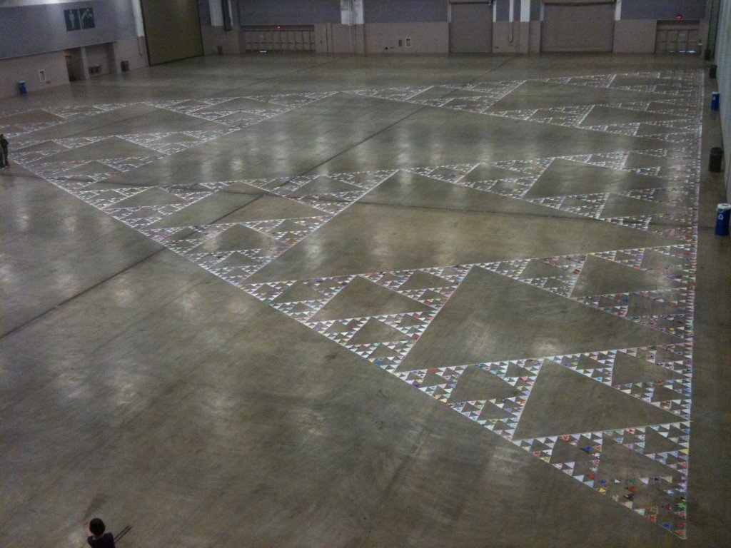 This is the current world record - made of 6561 (3^8) triangles. It was 192 feet across, and filled up the entire exhibit hall at the Albuquerque Convention Center.